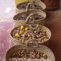 Argan Nuts in baskets Essaouira © 2012 KENZA International Beauty