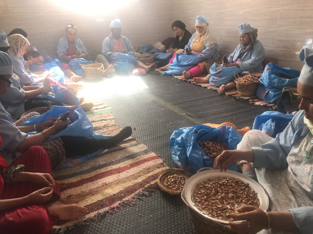 Women cracking Argan nuts at Cooperative Tirizite Arazane Morocco - by Khadija Fajry